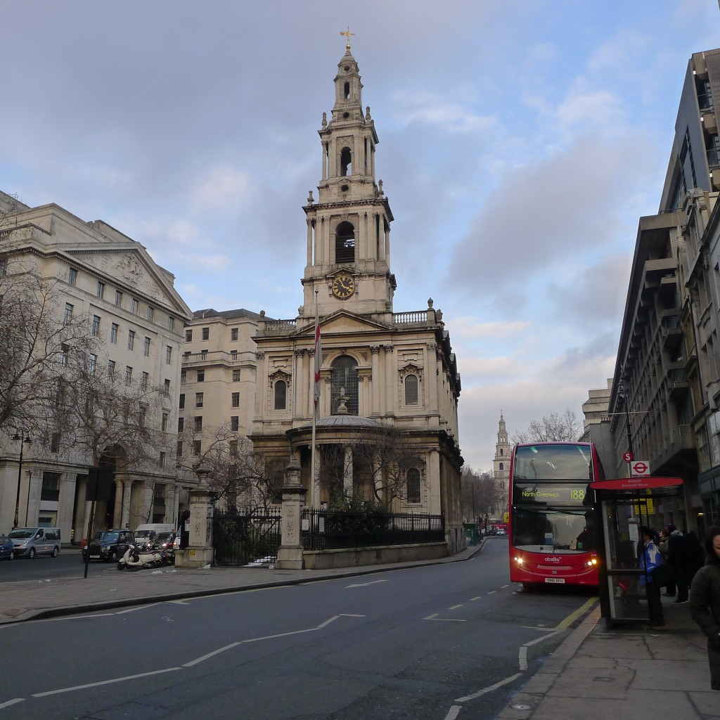 London church and red double decker bus