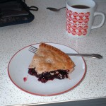 half-eaten piece of pie, mug of coffee, formica table top
